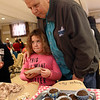 Wilmington-Tewksbury United Methodist Women hold their third annual Chocolate Festival, a fundraiser for local organizations that help women and children. Bob DiGuardia of Wilmington with granddaughter Olivia DiGuardia, 7, of Beverly. (SUN/Julia Malakie)
