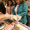 Wilmington-Tewksbury United Methodist Women hold their third annual Chocolate Festival, a fundraiser for local organizations that help women and children. Laila Reska, 10, of Wakefield, with great-aunt Debbie Sheridan of Billerica. (SUN/Julia Malakie)