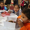 Wilmington-Tewksbury United Methodist Women hold their third annual Chocolate Festival, a fundraiser for local organizations that help women and children. From left, Nyla Chimwanda, 8, her sister Amara, 6, and brother Kai Chimwanda, 3, of Wilmington. (SUN/Julia Malakie)