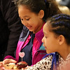 Wilmington-Tewksbury United Methodist Women hold their third annual Chocolate Festival, a fundraiser for local organizations that help women and children.  Nyla Chimwanda, 8, left, and her sister Amara, 6, of Wilmington, fill their plates. (SUN/Julia Malakie)