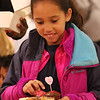 Wilmington-Tewksbury United Methodist Women hold their third annual Chocolate Festival, a fundraiser for local organizations that help women and children.  Nyla Chimwanda, 8, of Wilmington, fills her plate. (SUN/Julia Malakie)