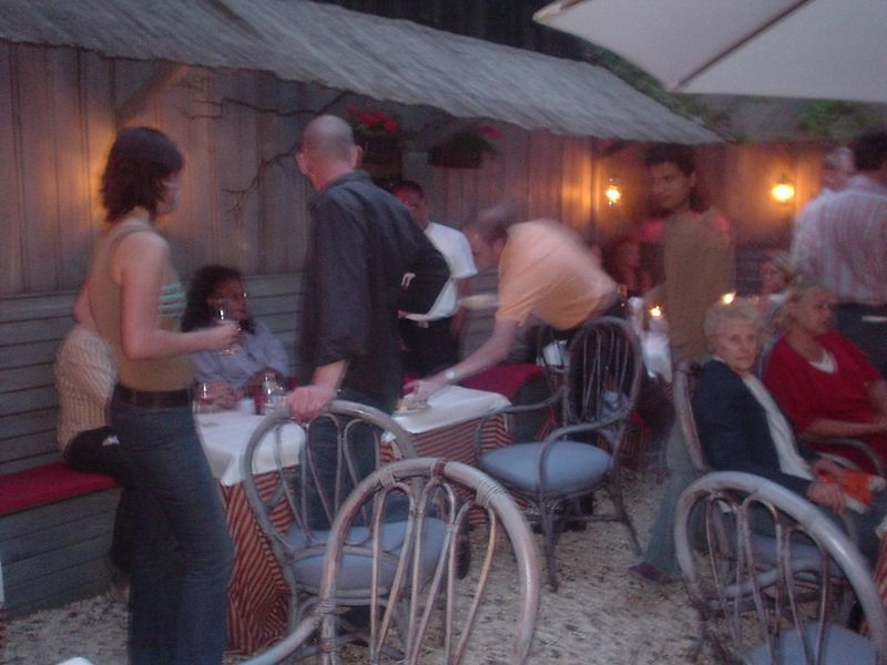 More party people in the garden... Jessica on the far left and the (blurry) chef/owner in the orange colored shirt in the middle (?)
