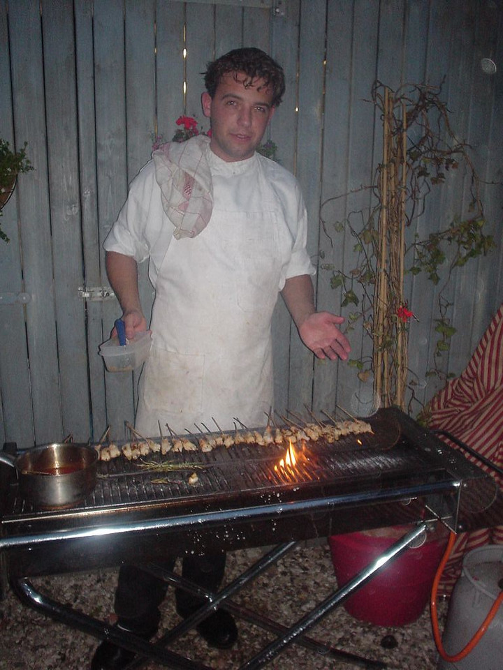 One of the cooks, while BBQing some gambas for us outside...