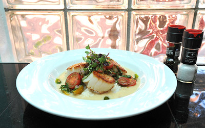 This is one of one of the dishes available at Walker's Drive In on N. State Street in the Fonderen area of Jackson, pan seared jumbo sea scallops with Florida rock shrimp, feta cheese, tomato salad and a charred tomato lemon-butter sauce. .