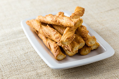 pastry sticks with cheese on white plate