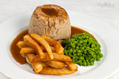 Chef's Presentation dish - Steak and kidney pudding; hand cut chips; peas.