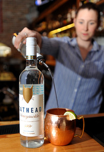 Bartender Jenifer Simcox pours up a Mississippi Mule with Cathead Vodka at Fondren Public in Fondren.