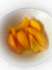Bowl of peach slices