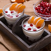 yogurt with pomegranate seeds and mandarin orange