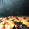 Nadav Soroker/Times-Georgian<br /> <br /> Barbecue chicken finishes smoking outside South of Heaven, on Saturday, August 25, 2018.