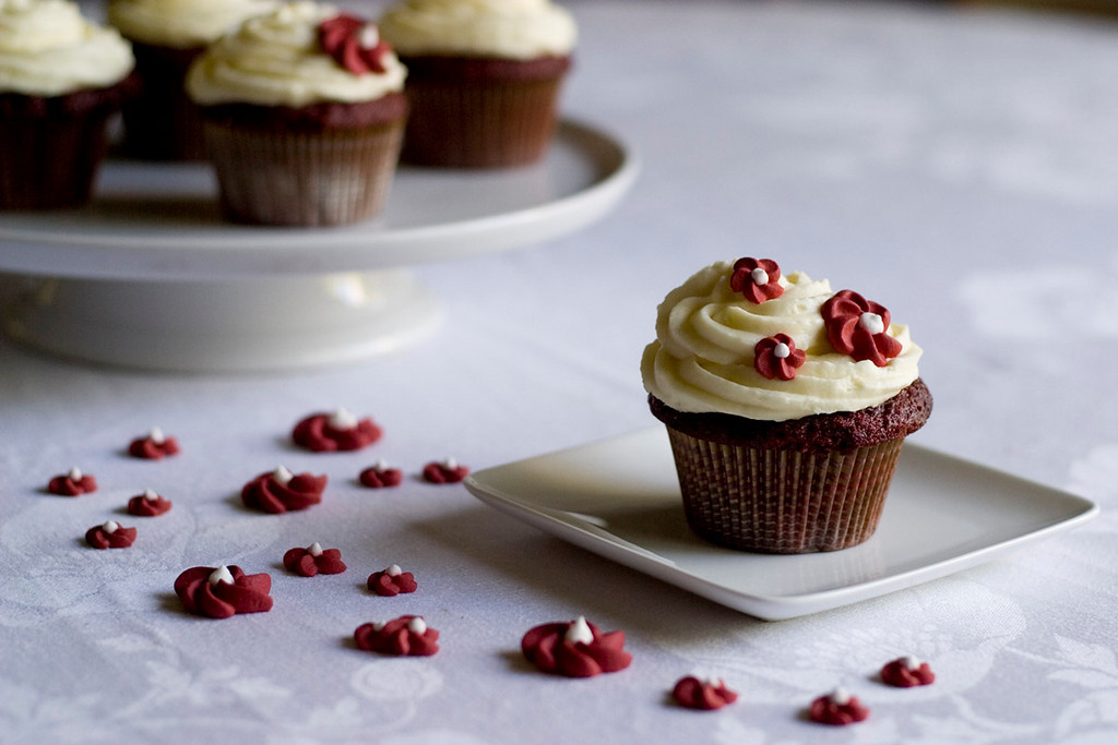 Red velvet cupcakes with mascarpone cream cheese icing and piped royal icing flowers.