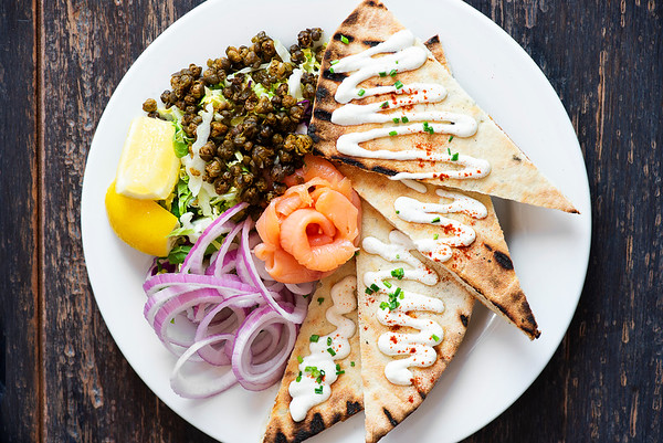 Smoked Salmon with Fried Capers, Red Onion, Horseradish Crème Fraîche & House-made Sage Flatbread