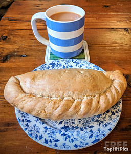 A Cup of Tea in Cornishware with a traditional Cornish Pasty