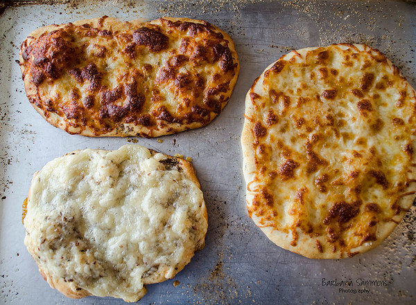 2-Ingredient Pizza Dough with various toppings