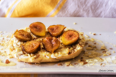 Roasted Figs, Drizzled with Honey on Toasted Bagel with Cream Cheese and Chopped Almonds