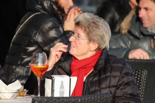 Italy, Verona, Senior Lady enjoying an afternoon Campari