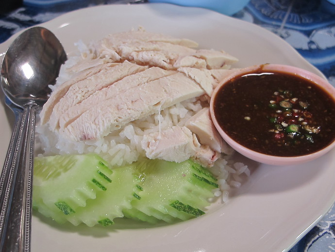 Khao Man Kai - strips of tender chicken layered over rice