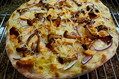 Smoked Salmon Pizza: sauteed chanterelles, smoked salmon, mozzarella, red onions and Piave Vecchio. Tasty