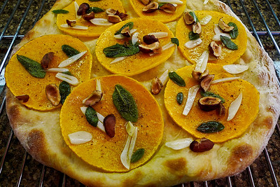 Butternut Squash Pizza: Getting experimental here with the squash, sauteed garlic slivers, olive oil marinated sage leaves, Oregon hazelnuts and some cracked pepper. Different looking but very tasty.