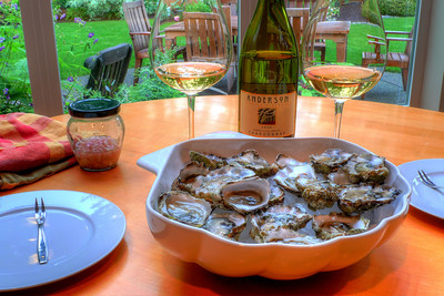 Tasty Puget Sound Kumamoto oysters from Taylor Shellfish Farm with a classic Champagne-vinegar mignonette accompanied by a 2006 Anderson Family, Dundee Hills, Oregon Chardonnay.
