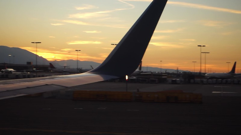 leaving sal lake city airport from tarmac at sunset