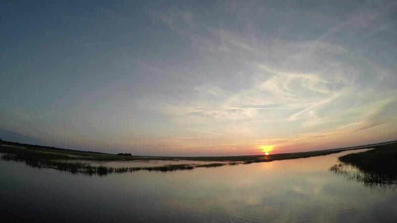 sunset on hunting island wetlands in south carolina