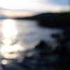 sunrise bokeh abstract over lake and water splashing noise