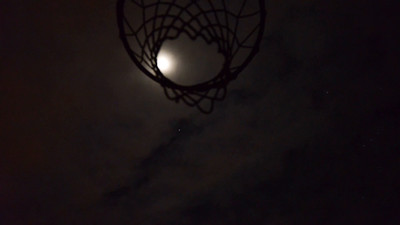 moon timelapse over basketball net