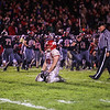 Chippewa Hills' Jonathan Hawley (68) kneels on the field after losing to Reed City Friday, Nov. 04, 2016. Final 34-28 Reed City. (PHOTOS BY KEN KADWELL -- FOR MIPREPZONE.COM).