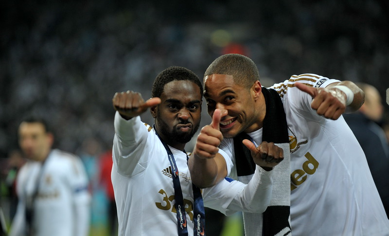 Swansea/Sport/Sunday 24 Feb 2013 Swansea V Bradford in the Capital one Cup final 2013 Ashley Williams and Nathan Dyer Celebrating after Swansea 5-0 win over Bradford in the Capital one Cup final 2013