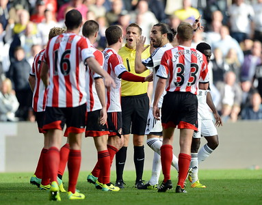 SPORT..... SWANSEA V SUNDERLAND..... SATURDAY OCTOBER 19th 2013 Action from Swansea City v Sunderland at the Liberty Stadium. Pictured : Referee, Craig Pawson