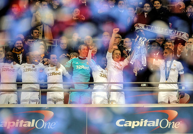 SPORT.... SWANSEA V BARDFORD...FANS..... SUNDAY 24th FEBRUARY 2013 Garry Monk and Ashley Williams lift the cup.