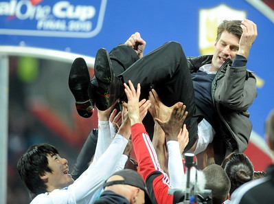 SPORT.... SWANSEA V BARDFORD...FANS..... SUNDAY 24th FEBRUARY 2013 Michael Laudrup is lifted into the air.