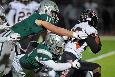 De La Salle's Vincent Bianchina (11) and De La Salle's Jake Lucas (45) tackle Pittsburg's Antwan Adger (29) in the second quarter of their North Coast Section Division I football championship game at Dublin High School in Dublin, Calif., on Friday, Nov. 29, 2019. De La Salle defeated Pittsburg 49-7 to win it's 28th consecutive NCS title. (Photo by Jose Santos Fajardo)