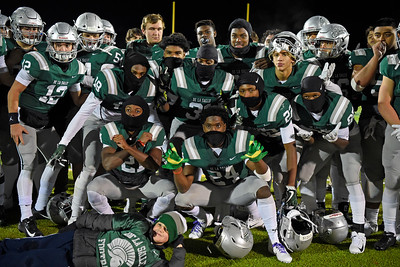 De La Salle players pose for a photograph after defeating Pittsburg during their North Coast Section Division I football championship game at Dublin High School in Dublin, Calif., on Friday, Nov. 29, 2019. De La Salle defeated Pittsburg 49-7 to win it's 28th consecutive NCS title. (Photo by Jose Santos Fajardo)