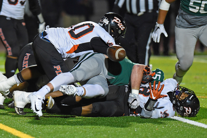De La Salle's Clayton Seastrand (15) tackles Pittsburg's  Avant Muldrow (8) and forces a fumble in the first quarter of their North Coast Section Division I football championship game at Dublin High School in Dublin, Calif., on Friday, Nov. 29, 2019. De La Salle defeated Pittsburg 49-7 to win it's 28th consecutive NCS title. (Photo by Jose Santos Fajardo)