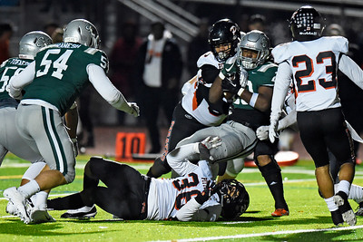 De La Salle's Mekhi Norfleet (20) pushes towards the end zone to score a touchdown against Pittsburg in the third quarter of their North Coast Section Division I football championship game at Dublin High School in Dublin, Calif., on Friday, Nov. 29, 2019. De La Salle defeated Pittsburg 49-7 to win it's 28th consecutive NCS title. (Photo by Jose Santos Fajardo)