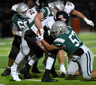 De La Salle's Clayton Seastrand (15) and De La Salle's Chad Tasi (57) sack Pittsburg quarterback Jerry Johnson (11) in the first quarter of their North Coast Section Division I football championship game at Dublin High School in Dublin, Calif., on Friday, Nov. 29, 2019. De La Salle defeated Pittsburg 49-7 to win it's 28th consecutive NCS title. (Photo by Jose Santo Fajardo)