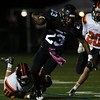 DAVID LE/Staff photo. Marblehead running back Jaason Lopez (23) gets dragged down by his shoelaces against Beverly. 10/7/16.