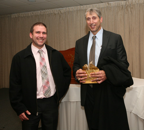 AMY SWEENEY/Staff photo.Mark Bavaro, Danvers native and two-time Super Bowl champion talks with the Danvers High coach Shawn Theriault at the Salem News 2016 High School Football All-Stars banquet held at Danversport Yacht club. 12/6/16