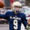 Record-Eagle/Brett A. Sommers Traverse City St. Francis' Dylan McCardel passes the ball during Saturday's pre-district playoff football. St. Francis won 28-6.