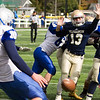 Record-Eagle/Brett A. Sommers Traverse City St. Francis' Nathan Schmuckal tries to block the punt of Calumet's Cooper Twardzik during Saturday's pre-district playoff football. St. Francis won 28-6.
