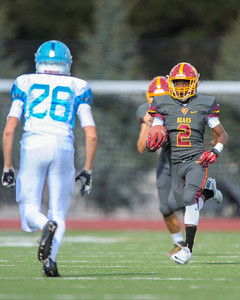 Menlo-Atherton's Marquise Reid runs back a 99 yard kickoff return against Hillsdale