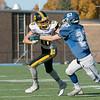 Lunenburg High School played Littelton High School on Saturday afternoon at Lunenburg Middle High School. Littleton's #10 Josh Crosswhite tries not to be tackled by Lunenburg's #27 Dawson Powell. SENTINEL & ENTERPRISE/JOHN LOVE