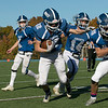 Lunenburg High School played Littelton High School on Saturday afternoon at Lunenburg Middle High School. Lunenburg's #12 Colin Sparague takes off with the ball after picking up a fumble. SENTINEL & ENTERPRISE/JOHN LOVE