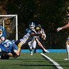 Lunenburg High School played Littelton High School on Saturday afternoon at Lunenburg Middle High School. Littleton's # 7 Timmy Kelleher reaches forward with the ball as he is tackeled by Lunenburg's #13 Anders Sarenpa and #75 Frank Nelson. SENTINEL & ENTERPRISE/JOHN LOVE