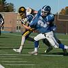 Lunenburg High School played Littelton High School on Saturday afternoon at Lunenburg Middle High School. Littleton's #10 Josh Crosswhite is tackled by Lunenburg's #27 Dawson Powell and #14 Mason Infantino. SENTINEL & ENTERPRISE/JOHN LOVE