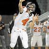 Minooka quarterbackJohn Carnagio tosses a pass against Oswego on Saturday night.