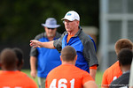 Florida Gator offensive line coach Mike Summers gives the recruits some advice before the start of a drill. 2014 Friday Night Lights.  July 25th, 2014. Gator Country photo by David Bowie.