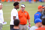 Florida Gator head coach Will Muschamp talks with a recruit during Friday Night Lights.2014 Friday Night Lights.  July 25th, 2014. Gator Country photo by David Bowie.